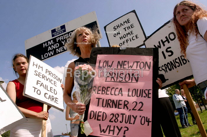 Protest at Low Newton Prison, near Durham against deaths in detention. 6/8 2004. Holding the pink placard is Pauline Campbell whose daughter Sarah died in custody. Photo - Mark Pinder - 2004-08-06