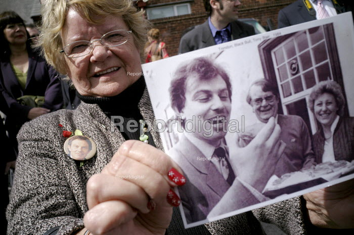 A supporter of Tony Blair, Lena Devine, attending his resignation timetable announcement rally holds up a photo of herself with Blair taken in sedgefield Village in 1984, the year after he became member of Parliament for the constituency. - Mark Pinder - 2007-05-10