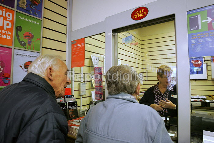 Customers queuing to use the services of Post Office, North Shields. - Mark Pinder - 2004-11-01