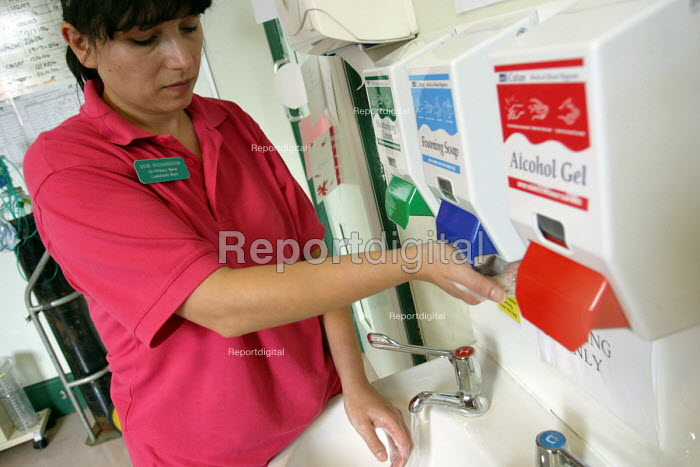 A nurse washes her hands at a sink and hygiene dispensers, Hunters Moor Hospital, Newcastle Upon Tyne. - Mark Pinder - 2004-07-15