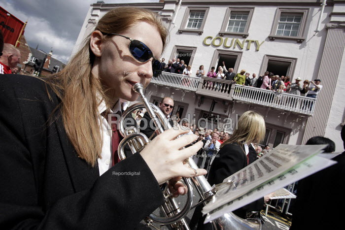 A brass band passes the guests on the balcony of the County Hotel at the 2009 Durham Miners Gala. - Mark Pinder - 2009-07-11