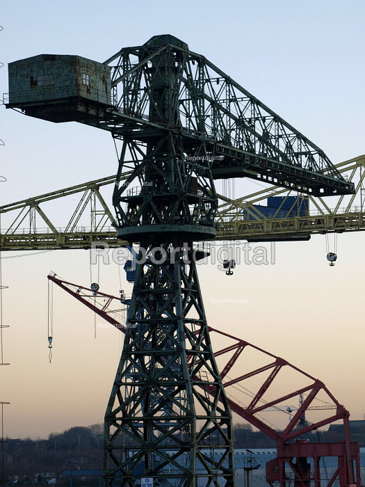 The cranes of Swan Hunter shipyard in Wallsend on the River Tyne are to be consigned to history following the closure of the yard. The cranes are being dismantled and exported to the Bharati Shipyard Ltd of Mangalore India following the Indian shipbuilders purchase of the yard in April 2007. Wallsend near Newcastle Upon Tyne. - Mark Pinder - 2007-12-11