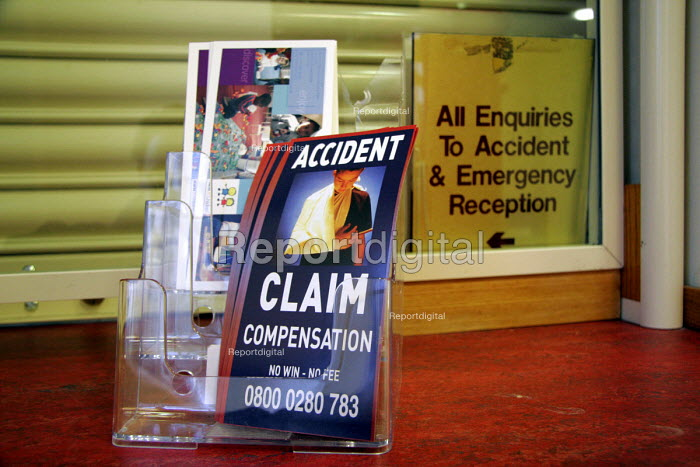 Literature and cards left by a 'no win no fee' solicitors firm at the reception to Newcastle General Hospital. 12/4 2005. - Mark Pinder - 2005-04-12