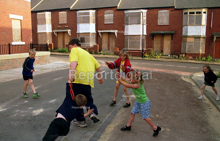 Children playing in front of derelict and boarded up private flats and houses, North Benwell, Newcastle Upon Tyne - Mark Pinder - 1999-06-25