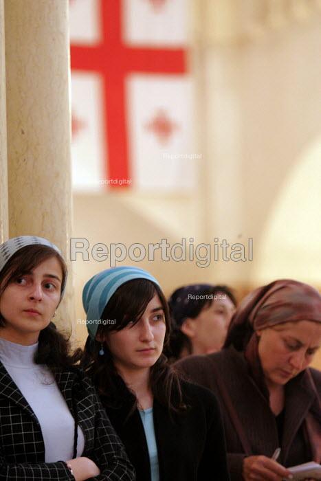 Women beneath the Georgian flag at Friday Mass at the Georgian Orthodox Sameba Church, Tbilisi, Georgia, 20/5 2005. - Mark Pinder - 2005-05-20