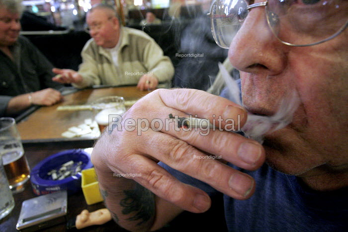 A smoker in the Brigham and Cowan working men's club, South Shields on the day that parliament voted to ban smoking in all enclosed public places in England. Tuesday. - Mark Pinder - 2006-02-14