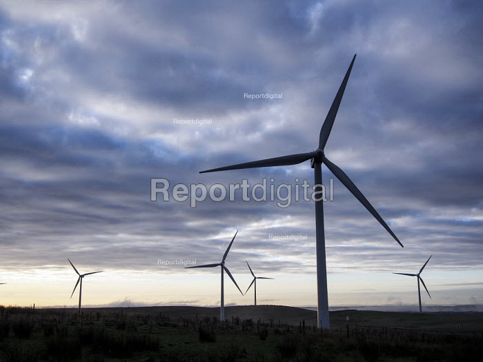 Electricity generating wind turbines shrouded by the dawn mist. Near Ridsdale, Northumberland - Mark Pinder - 2013-09-14