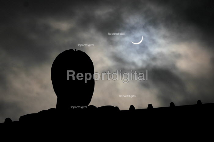 The 2015 UK solar eclipse as the moon moves infront of the sun. Angel of the North, Gateshead, Tyne and Wear. - Mark Pinder - 2015-03-20
