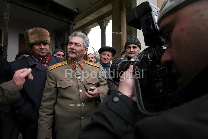 Georgian supporters of Joseph Stalin congregate on the 21st of December every year to commemorate the late dictators birthday in Stalins home town of Gori about 50 miles west of the Georgian capital Tbilisi. - Mark Pinder - 2005-12-21