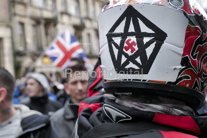 Pegida supporter wearing a motorcycle helmet with a swastika in a Star of David, Pegida rally, Newcastle Upon Tyne - Mark Pinder - 2015-02-28
