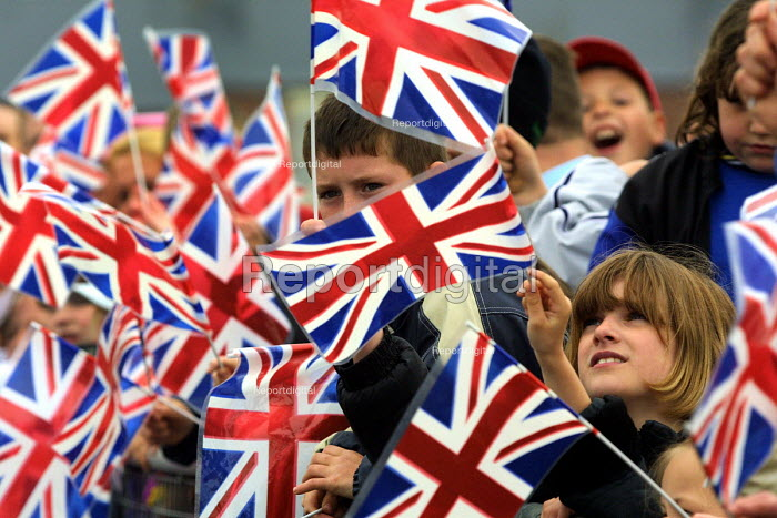 Children wave Union Jacks at the departure of the Queen from Easington Colliery Co Durham. The Queen visited the village as part of her Jubilee Tour - Mark Pinder - 2002-05-08
