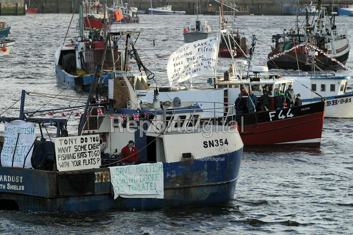 Flotilla of fishing boats as North east Cod fishermen protesting against European regulations which will further restrict fish quotas by up to 79 to protect stocks of cod, haddock and whiting reaching the point of extinction. The trawlermen say the fishing industry will be destroyed. North Shields. - Mark Pinder - 2002-12-11