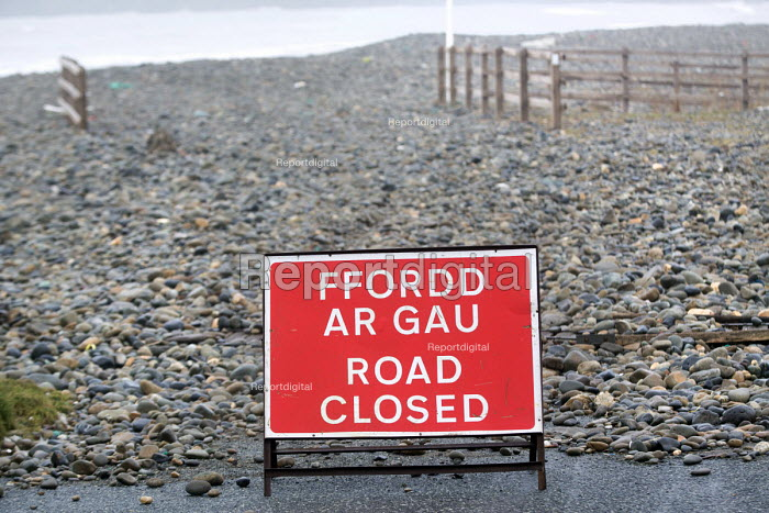 Road closed. Storm waves move a pebble sea defence bank, completely covering the road in Newgale, Pembrokeshire, Wales. - Paul Box - 2014-01-08