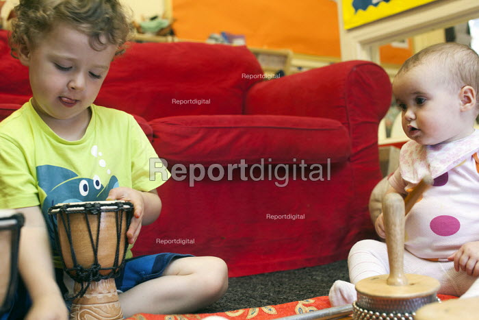 Children play with musical instruments, Norland Nursery, Bath. - Paul Box - 2012-06-27