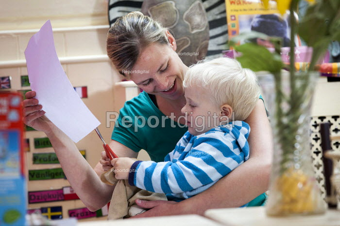 A young boy playing and a nursery worker, Norland Nursery, Bath. - Paul Box - 2012-06-27