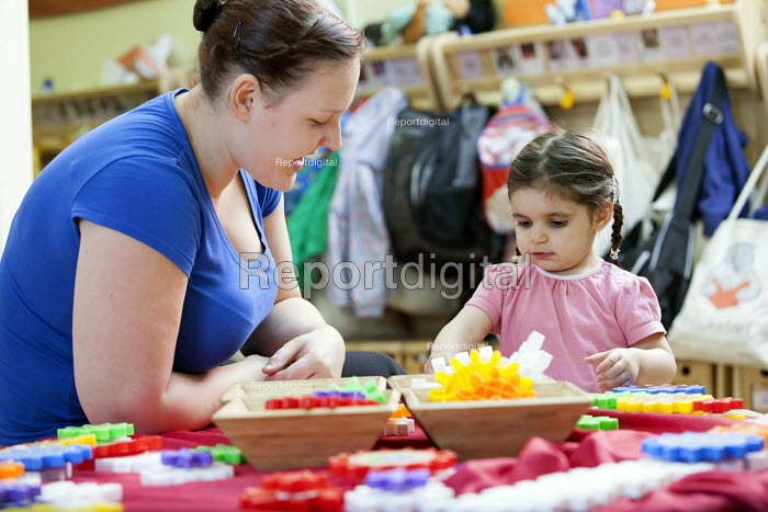 A young girl playing and a nursery worker, Norland Nursery, Bath. - Paul Box - 2012-06-27