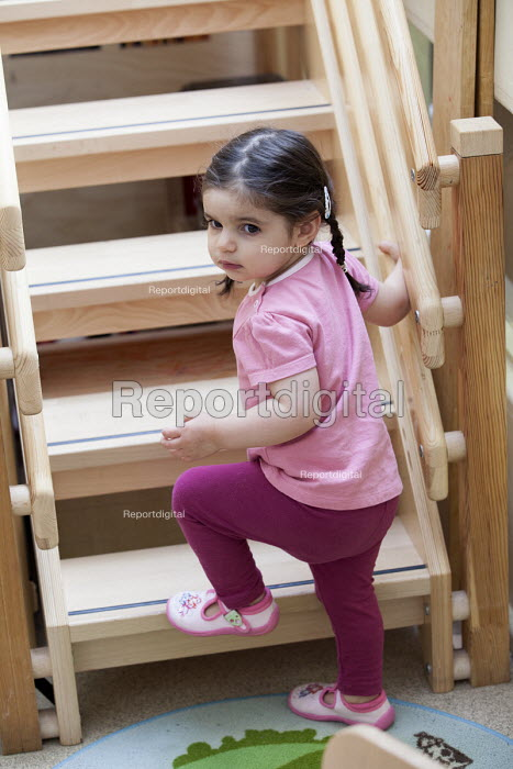 A young girl climbing the stairs, Norland Nursery, Bath. - Paul Box - 2012-06-27