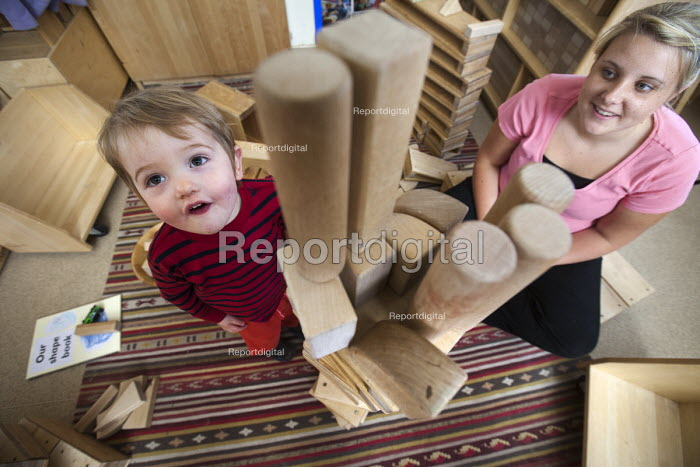 A young boy playing with wooden blocks and a Nursery worker, Norland Nursery, Bath. - Paul Box - 2012-06-27