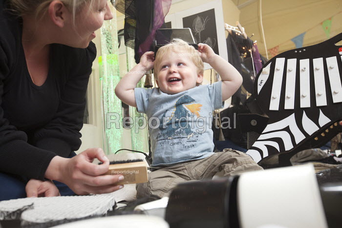 A young boy playing, with encouragement from a nursery worker. Norland Nursery, Bath. - Paul Box - 2012-06-27