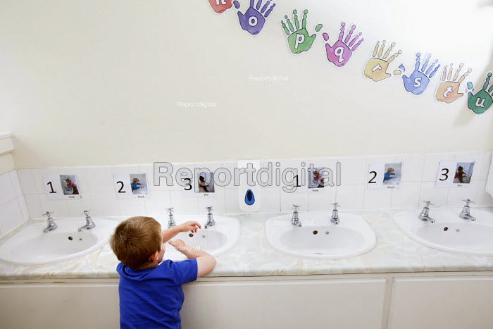 A young boy washing his hands in the toilet, Norland Nursery, Bath. - Paul Box - 2012-06-27