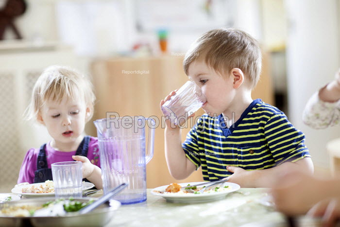 A young boy drinking a glass of water, Norland Nursery, Bath. - Paul Box - 2012-06-27