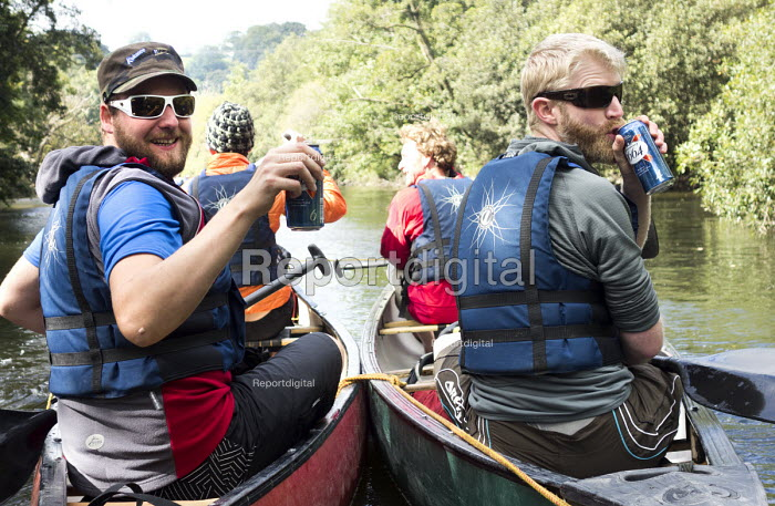 A stag party canoes down the river Teifi, Pembrokeshire, Wales. - Paul Box - 2013-09-07