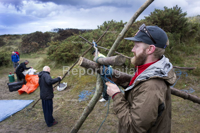 A stag party- building a shelter for sleeping at Poppit sands, Cardigan, Pembrokeshire, Wales. - Paul Box - 2013-09-07