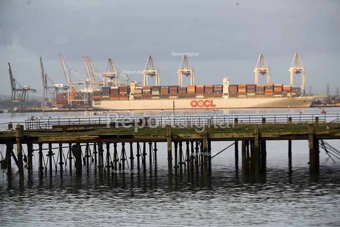 Derelict pier, OOCL Cargo ship Southampton - Paul Box - 2015-01-07