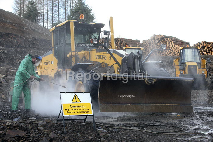 Afan forest, South Wales. Phytophthora ramorum - a devastating fungal pathogen - is causing widespread damage to trees in the UK. Contractors use high pressure steam to clean, site vehicles to prevent the spread of the fungus. - Paul Box - 2011-02-15