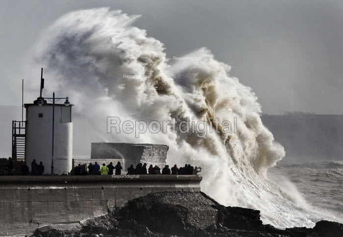 Storm waves smash into the seafront, lighthouse and seawall, Porthcawl, Wales - Paul Box - 2014-02-08