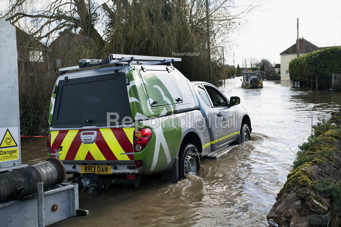 An environment agency 4 wheel drive vehicle takes pump infrastructure through floodwater at Moorland, on the Somerset levels. - Paul Box - 2014-02-07