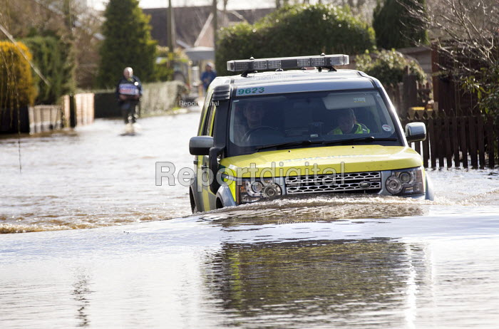 A 4wd Ambulance drives through floodwater at Moorland, on the Somerset levels. - Paul Box - 2014-02-07
