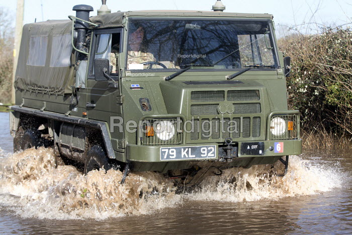 An army vehicle drives through floodwater at Moorland, on the Somerset levels. - Paul Box - 2014-02-07
