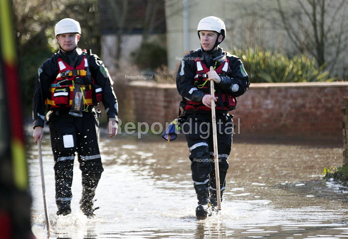 Police walk the streets of Moorland checking on residents, on the Somerset levels. - Paul Box - 2014-02-07