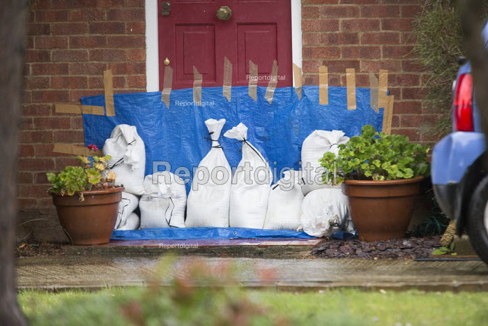 Sand bags and ground sheet used to protect house from flood water, Wraysbury, Berkshire after the Thames burst its banks. - Paul Box - 2014-02-12
