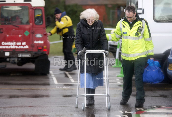 Ambulance workers helping an elderly woman, Wraysbury, Berkshire after the Thames burst its banks. - Paul Box - 2014-02-12