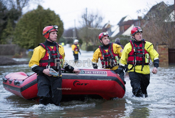 West Midlands Fire service wade through flood waters to check on residents, Wraysbury, Berkshire. - Paul Box - 2014-02-12