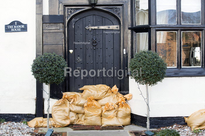 A expensive home has sandbags on its doorstep in Datchet , Berkshire which has been flooded after the Thames burst its banks. - Paul Box - 2014-02-13