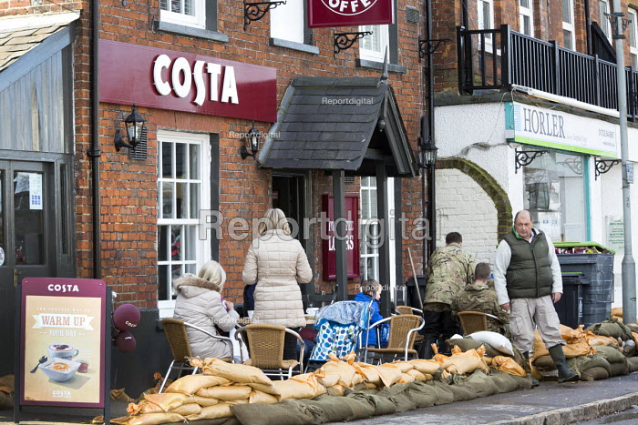 Sandbags protect a Costa coffee shop in Datchet , Berkshire which has been flooded after the Thames burst its banks. - Paul Box - 2014-02-13