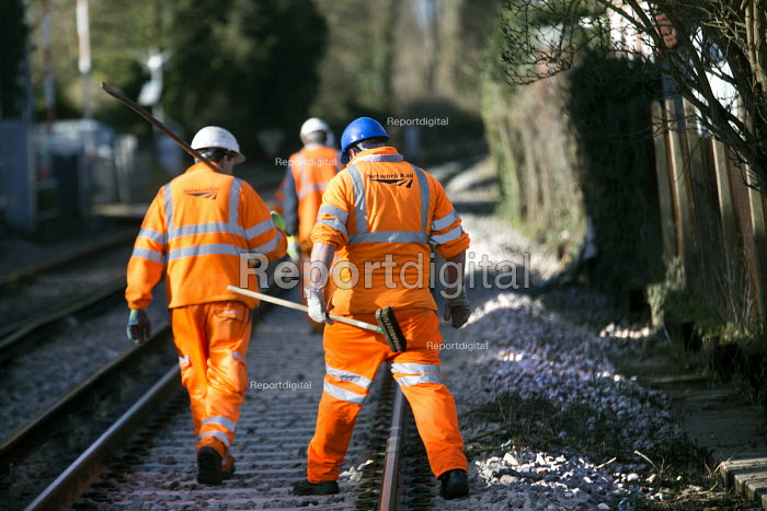 Network rail workers clean up after the railway line flooded in Datchet , Berkshire which has been flooded after the Thames burst its banks. - Paul Box - 2014-02-13