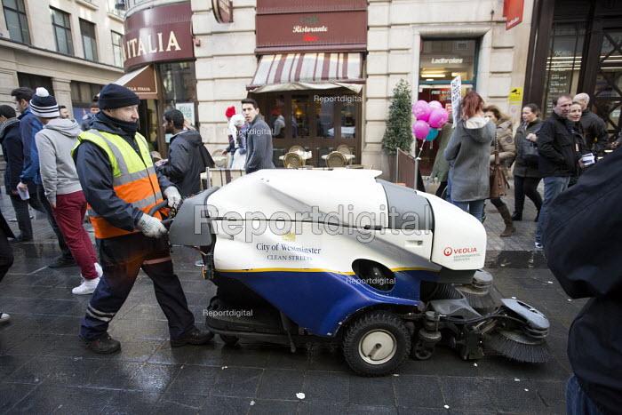 A street cleaner on Oxford street, London - Paul Box - 2014-02-15