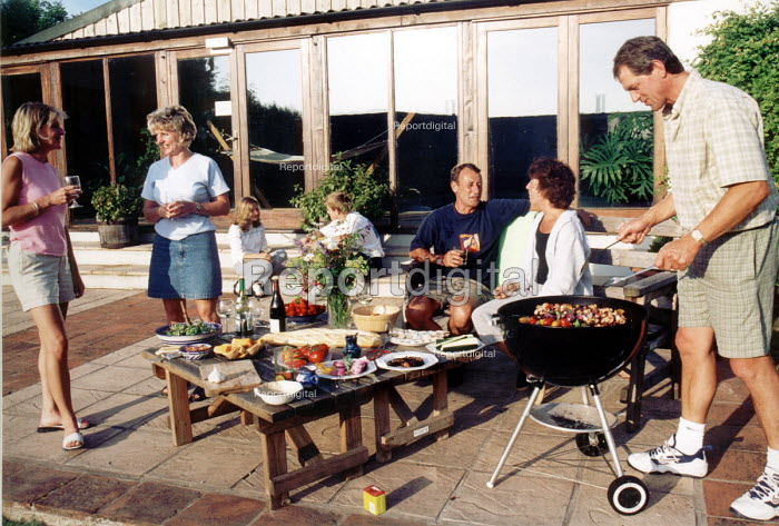 Drinking and relaxing on the patio as food being cooked on a Barbecue - Paul Box - 2001-06-25