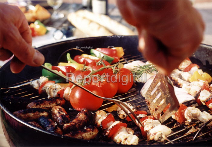 Food being cooked on a Barbecue in the garden - Paul Box - 2001-06-25