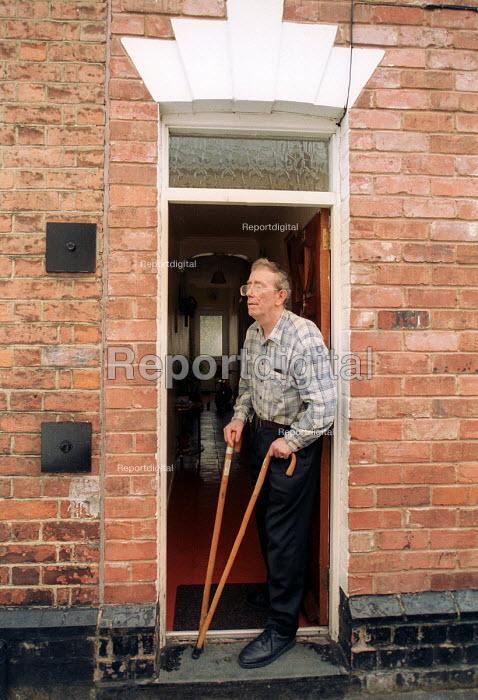 Elderly disabled man on doorstep. Gloucester - Paul Box - 2001-05-14