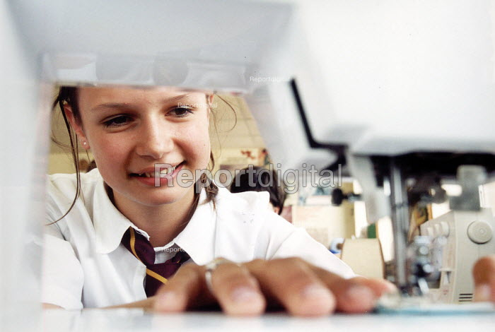 Pupil of Hanham High School, Bristol using sewing machine in a domestic sciences lesson. - Paul Box - 2001-06-15