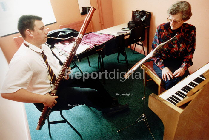 Pupil of Hanham High School, Bristol playing a bassoon in a music lesson - Paul Box - 2001-06-15