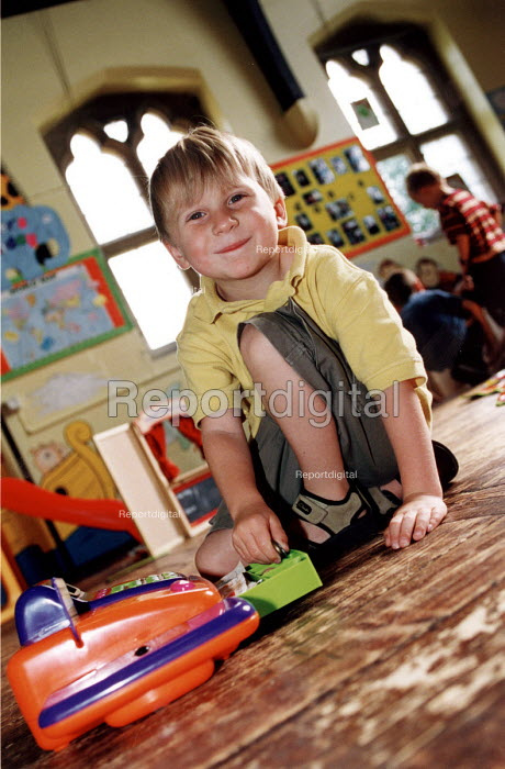 Child playing with toys at a playscheme in Gloucestershire - Paul Box - 2002-07-19