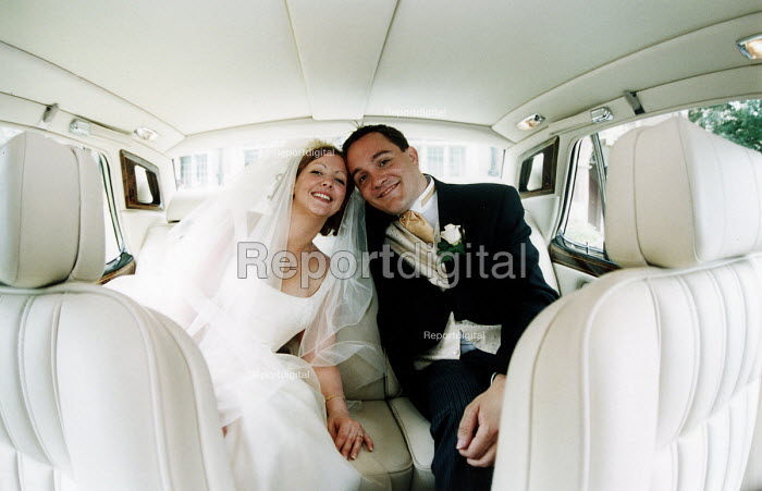 Bride and groom arrive at their wedding in a limousine - Paul Box - 2002-07-14