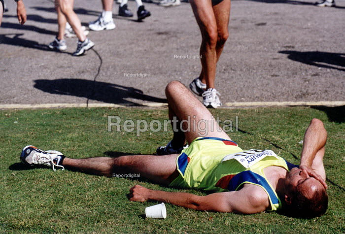 Runner collapses with exhaustion after running a marathon, fun run Bristol - Paul Box - 2000-07-14