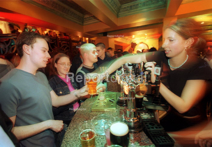 Bar staff at The Bohemia Pub in Bristol pouring pints - Paul Box - 2001-11-23